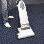 man is cleaning the carpet vacuum cleaner